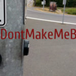 Photo of a button which says push to cross, with an added hashtag DontMakeMeBeg